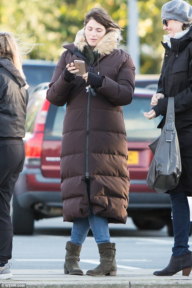 Casual:Gemma smothered her slender figure in a huge brown puffer coat