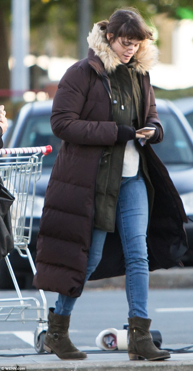 Time for a selfie? The British actress also browsed and laughed at her phone on set