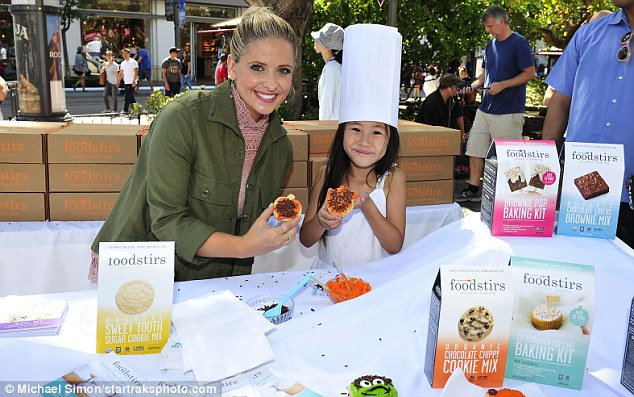 About to take a bite: Sarah Michelle glowed while at her company's cookie decorating and food crafting event at the outdoor mall in LA