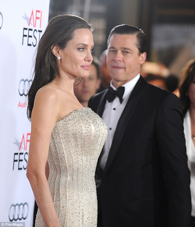 He won't stab her in the back: 'There is so much stuff of Angelina but Brad just doesn't want to go there. He told his team he doesn't want to play dirty,' the source claimed; here they are seen during their last red carpet appearance together in November
