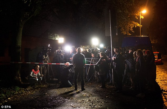 Detective Chief Superintendent Tom Bernhardt, addresses reporters at a sealed residential area in Chemnitz yesterday