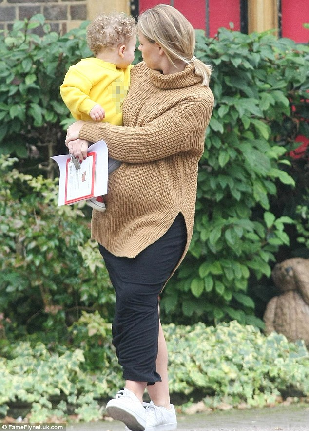 Joining the mummy club: Kim says Cheryl and Nicola Roberts get broody around her child