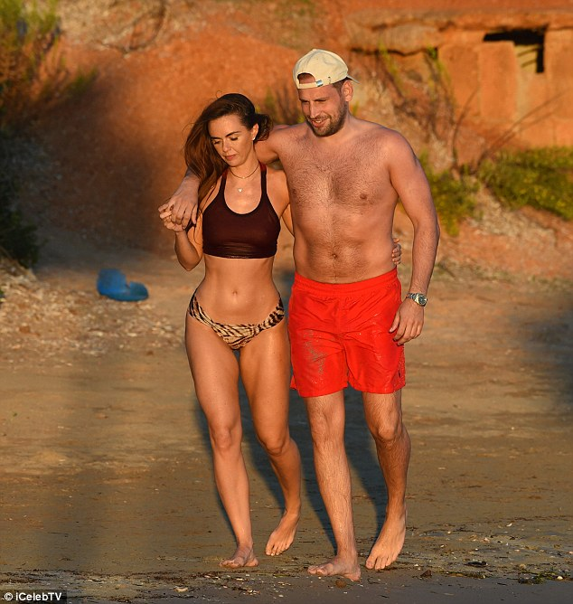 Loved-up! The pair walked up the beach in Ibiza hand-in-hand