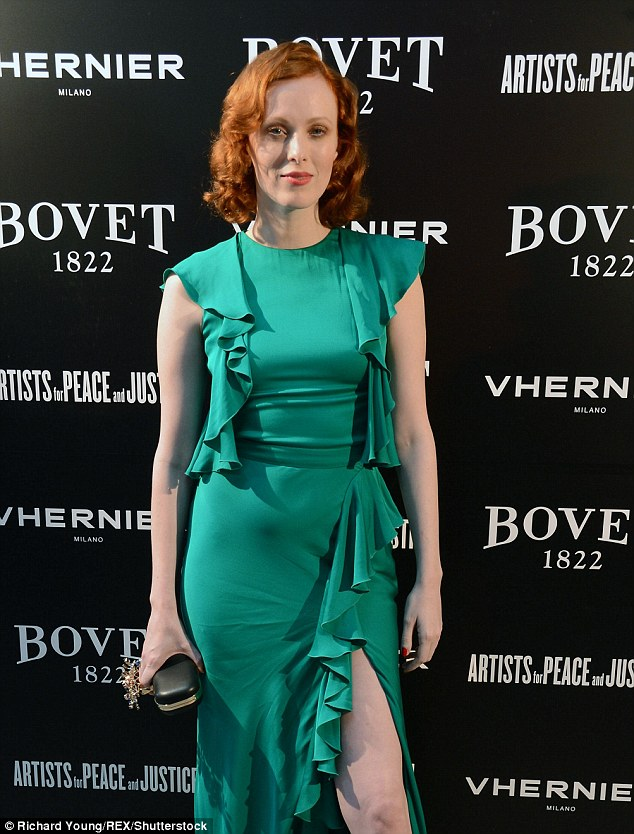 Green delight: She wowed as she arrived at the event in a form-fitting ruffled green dress