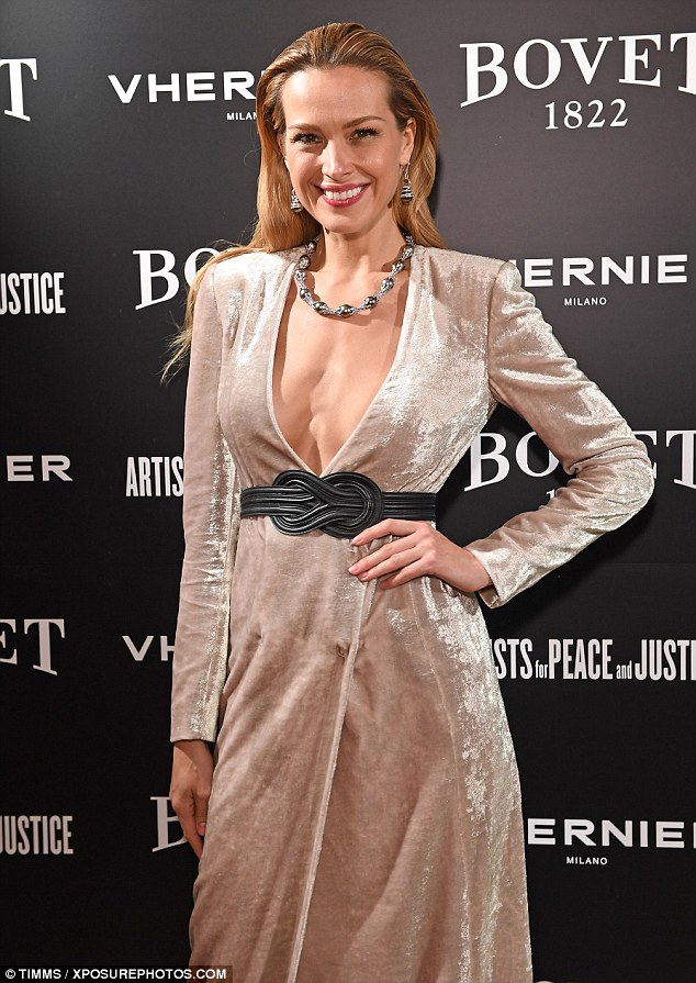 Taking the plunge: She showed off a considerable amount of chest in her plunging gown