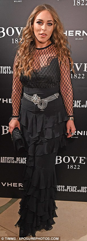 Meshing together well: Chloe Green wore a black layered dress with a mesh overlay on top