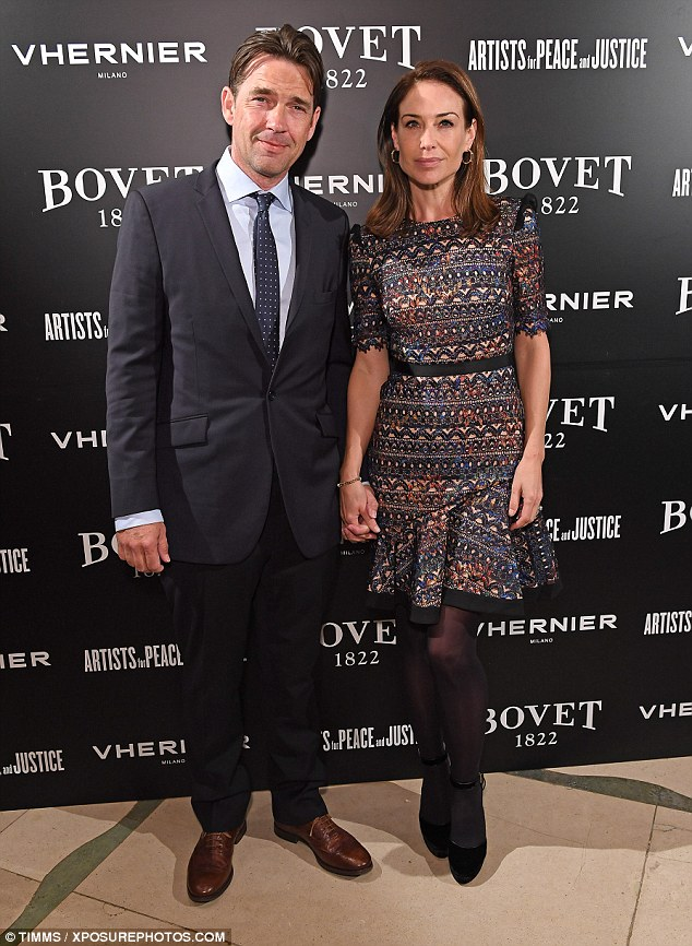 Give them a hand! Dougray Scott and Claire Forlani held hands as they arrived at the event