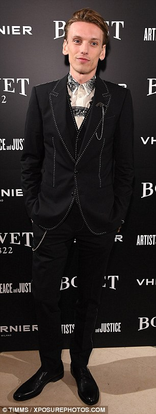 Dapper gent: Jamie Campbell Bower turned heads in a black suit with white stitching