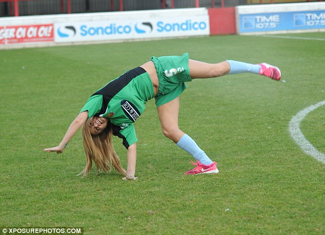 Head over heels: She also displayed her athleticism as she prepared to do a handstand