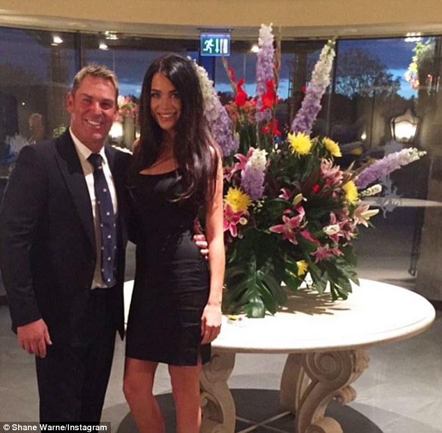 'Sara is rocking her black dress': Fans of Shane Warne went into meltdown after the playboy cricketer shared a photo of his 'date' with former reality star Sara McLean on Sunday night