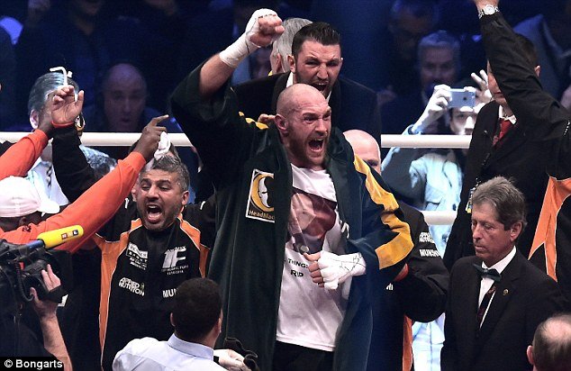 Fury (centre) beat Wladimir Klitschko last November but has twice pulled out of the rematch