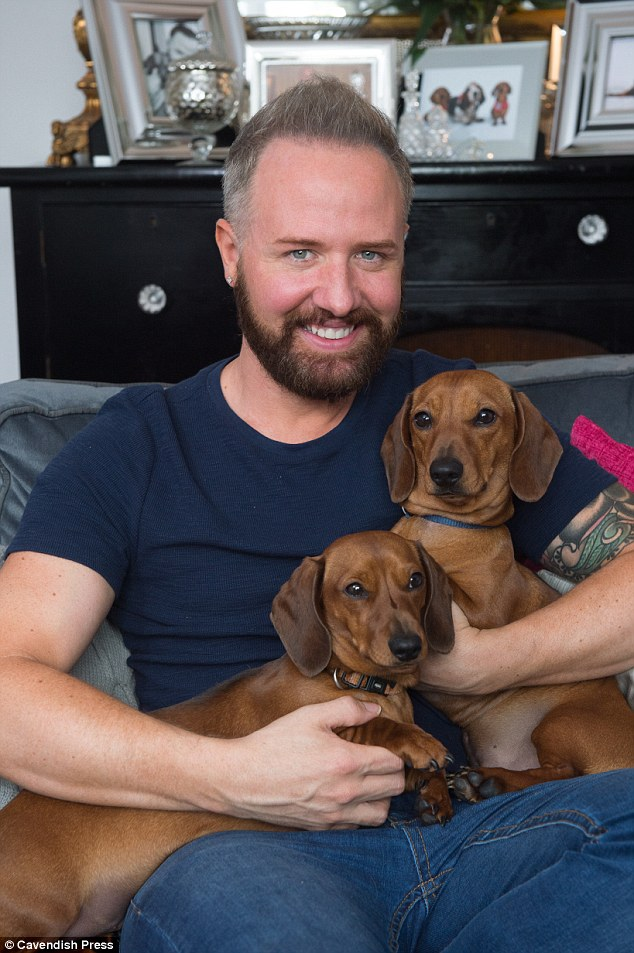 Chris shows off the result of his £10,000 hair transplant as he poses with his miniature dachshunds Rusty (left) and Buddy (right)