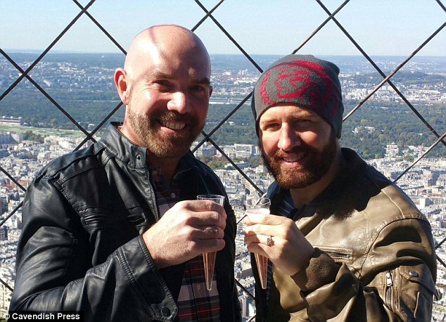 He has since become engaged to landscape gardener Tony Butland (left), pictured here together celebrating Mr Butland's proposal at the Empire State Building