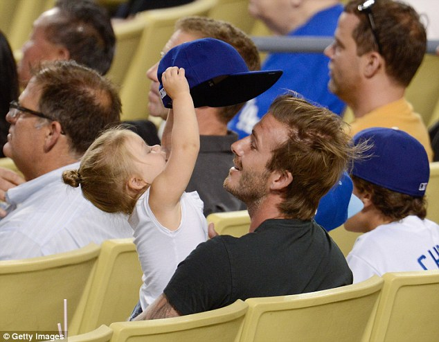 Father and daughter: David and daughter Harper Beckham attend a baseball game between the Chicago Cubs and the Los Angeles Dodgers in 2014