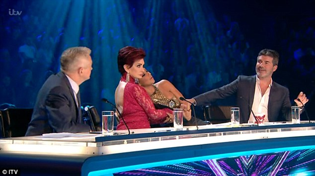 Awkward! Louis Walsh, Sharon Osbourne, Nicole Scherzinger and Simon Cowell now make up the panel