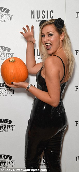 Claws out: With a pumpkin in one hand, Larissa clawed with the other
