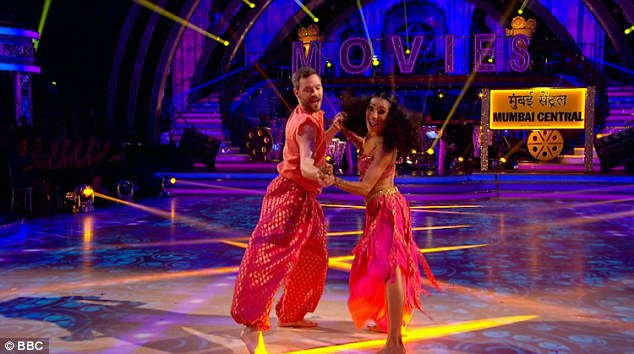 Full of colour: The singer and his dance partner Karen Clifton danced to the Pussycat Dolls' Jai Ho from the Slumdog Millionaire soundtrack as part of movie week