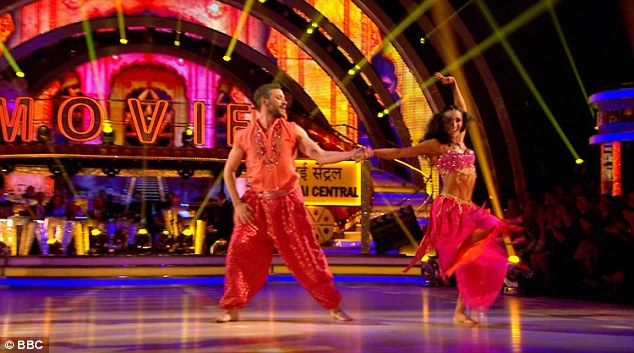 Authentic: Will and Karen wore Indian-inspired outfits for the energetic performance
