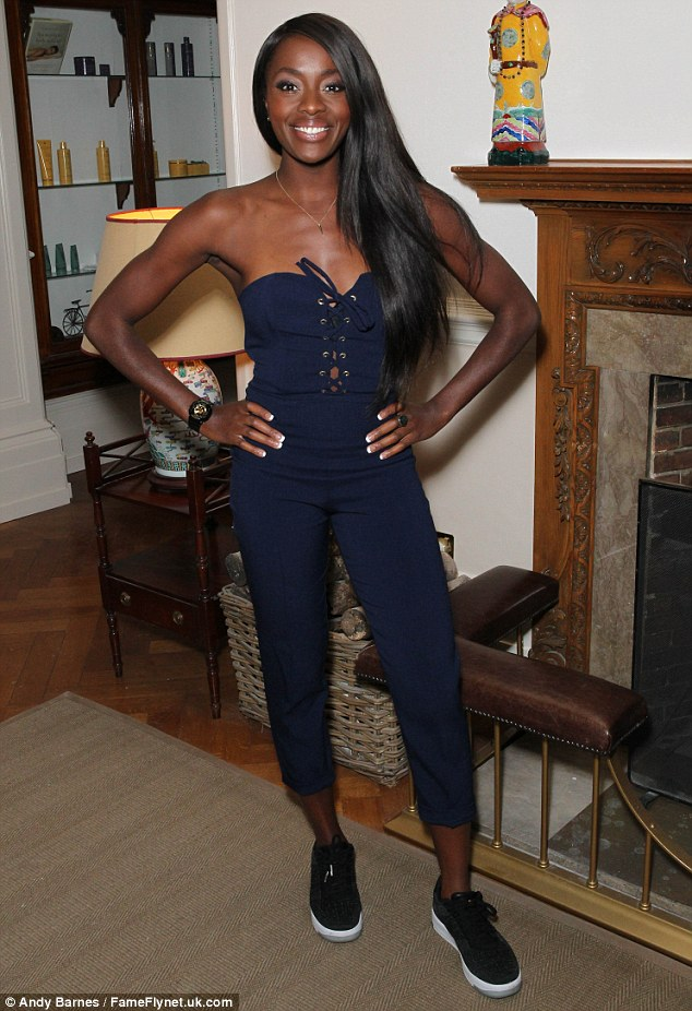 Casual cool: TV presenterAJ Odudu also ventured to the day out in a navy lace-up jumpsuit and cool sports trainers