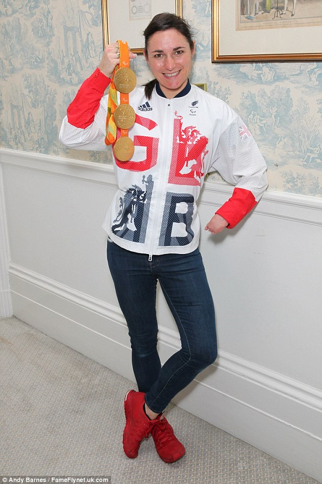 Golden girl: Olympic cyclistSarah Storey arrived at the event - with her famous 2012 bling in tow