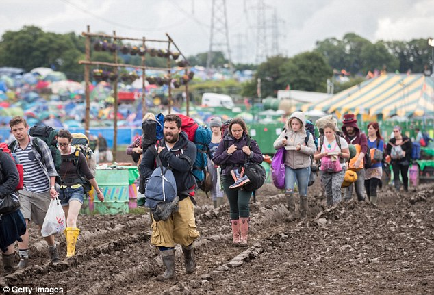 Festival goers leave the site in Worthy Farm last year after one of the wettest summers of the event