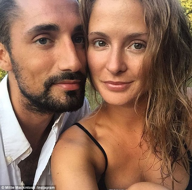 Loved-up: Hugo rekindled his romance with Millie Mackintosh earlier this year after the brunette split from her now ex-husband Professor Green