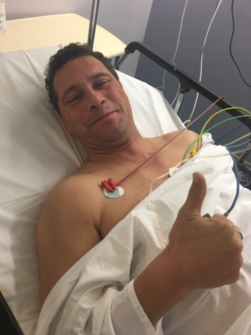 Steven Woolfe, pictured, gave a thumbs up gesture in hospital as he recovers from injuries sustained in a 'scuffle' following clear-the-air talks with fellow Ukip MEPs in Strasbourg