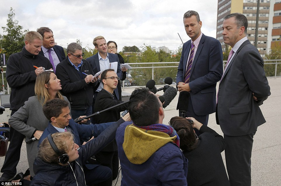 Speaking to reporters outside the hospital after visiting Mr Woolfe this morning, Nathan Gill (pictured second right) 'it was at one stage touch and go' yesterday but said his 'good friend' Mr Woolfe was now 'in 'extremely good form'