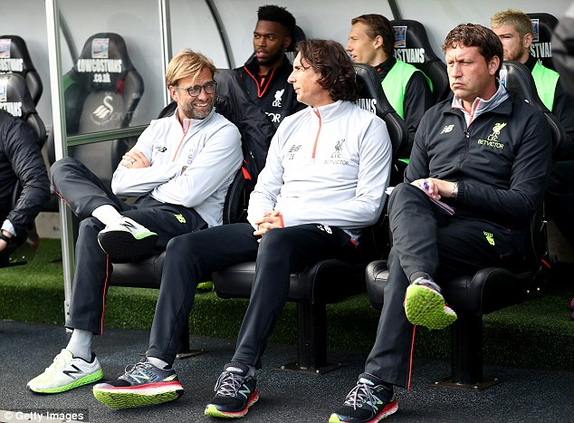 Reds assistantZeljko Buvac (centre) plays a crucial role in preparing the players on match day