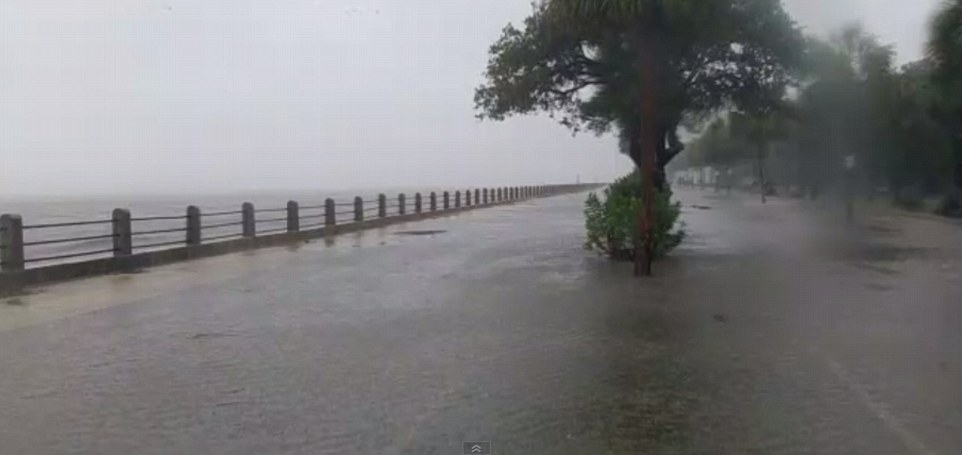 The landmark defensive seawall, could not hold back the waves as the tide rushed in and submerged the promenade of the popular tourist destination