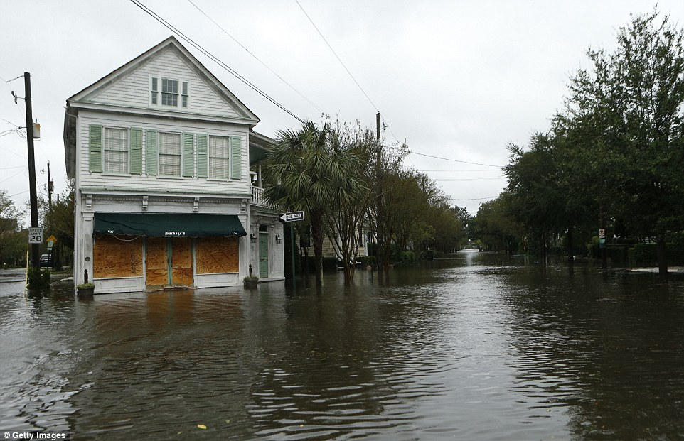 The geography of Charleston (pictured on Saturday afternoon) made the low-lying port city especially vulnerable to Matthew