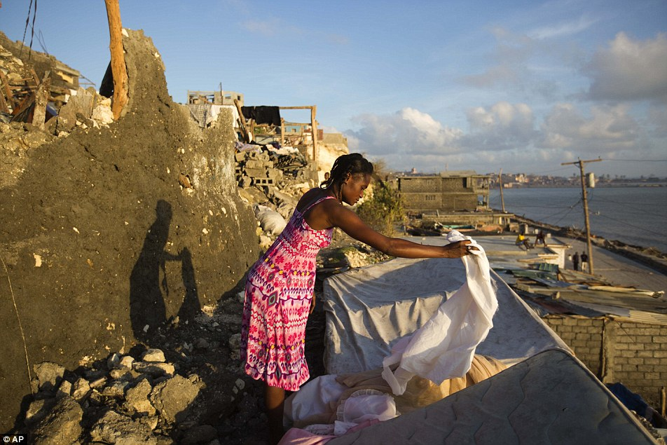 Andrenne Joseph dries her clothes near her destroyed house caused by Hurricane Matthew, in Jeremie. Some areas of Haiti's south faced 'completely destruction' after the storm passed directly through the Tiburon peninsula