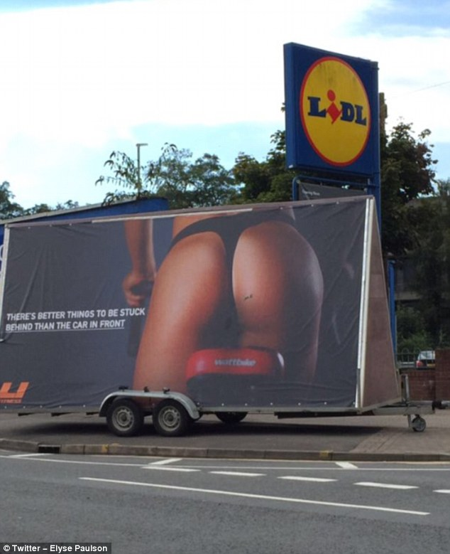 The poster, which shows a woman's thong-clad derriere sitting on  an exercise bike, reads: 'There's better things to be stuck behind than the car infront' and was installed in Cardiff