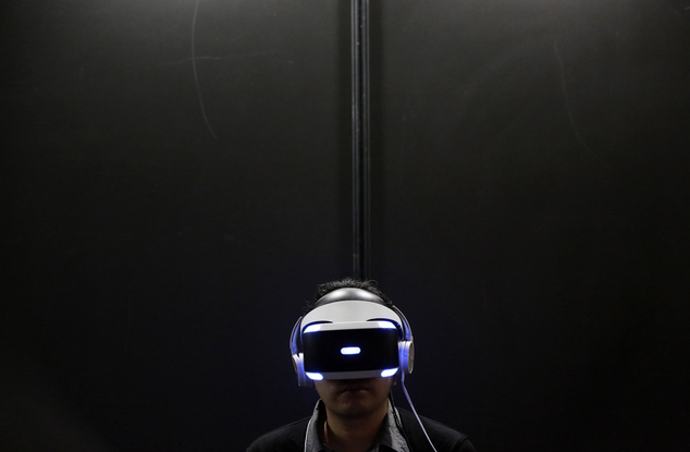 A visitor tries out a PlayStation VR headgear device at the Tokyo Game Show in Makuhari, near Tokyo. Unlike the Oculus Rift and HTC Vive, PlayStation VR works in unison with a PlayStation 4 console instead of a high-end PC. It's also cheaper, more comfortable and will be the most convenient option for VR seekers when it's released Oct. 13.