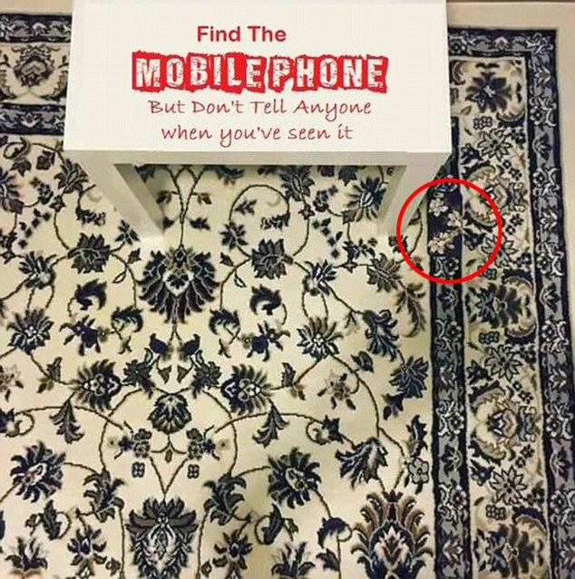 Confused? The handheld device lies just beside the right side table leg at the top of the photo