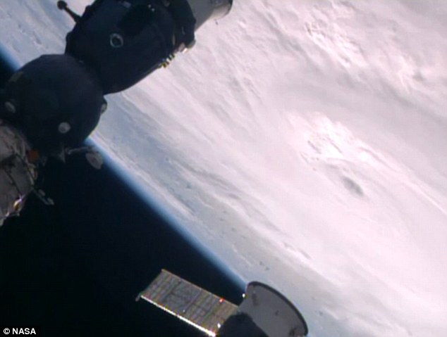 Filmed on cameras next to the International Space Station, the footage shows a mass of cloud gathered around the swirling centre of the weather system
