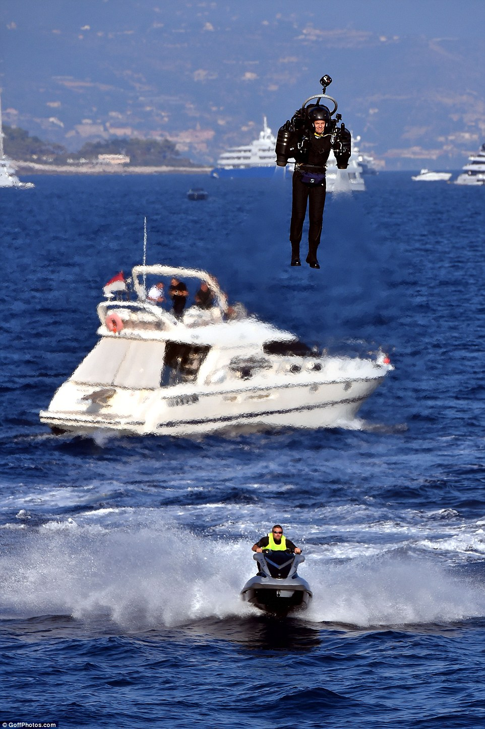In a flight lasting more than two minutes crowds watched the pilot fly over the deep blue Mediterranean waters