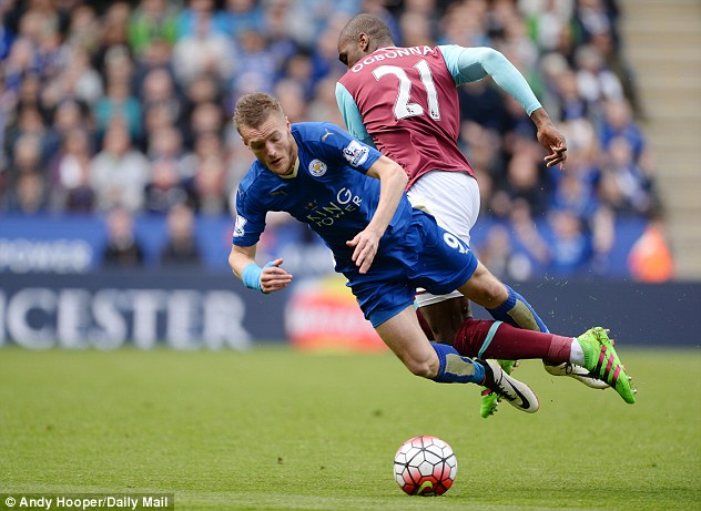 Vardy (left) collides in the penalty area with West Ham's Angelo Ogbonna and receives a second yellow card