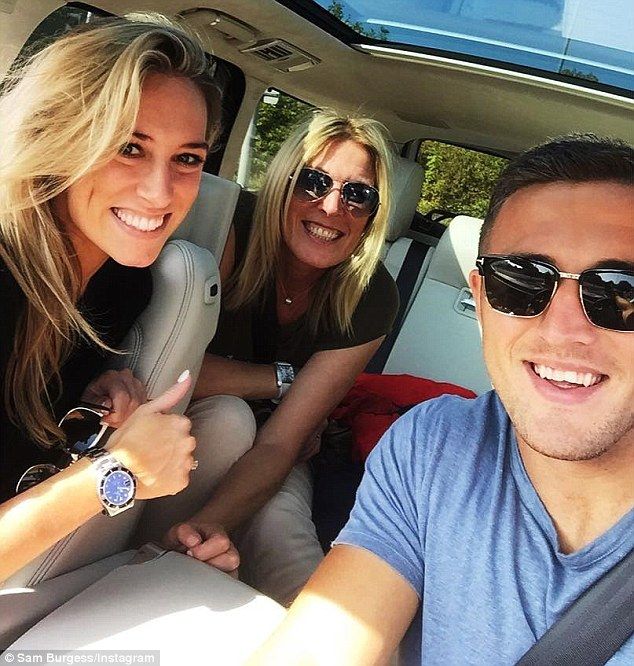 Burgess poses for a selfie in his car during his Bath days with fiancee Phoebe (left) and mother Julie (centre)