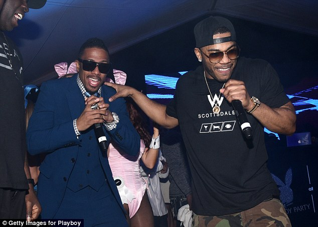 Actor Nick Cannon (left) and rapper Nelly (right) perform at a Playboy Party during Super Bowl weekend