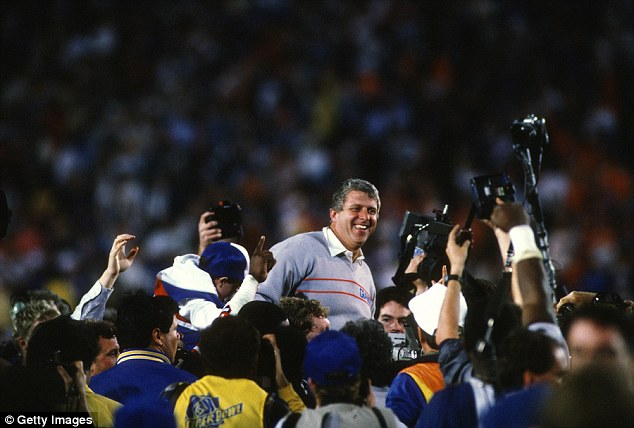 Head coach Bill Parcells is lifted into the air after the New York Giants beat the Denver Broncos