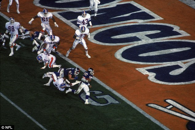 New York Giants running back Joe Morris scores a touchdown at the Rose Bowl in California
