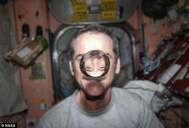 Chris Hadfield, the former commander on the ISS, pictured playing with water and the lack of gravity