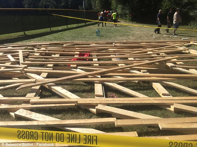 A 10-year-old child and three adults have been hospitalized with injuries from the collapse of a climbing structure (above, after the collapse) during a 5K obstacle race in Louisiana