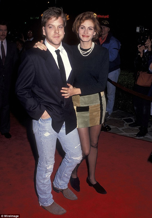 What a handsome pair: The couple are seen at the Sleeping With The Enemy premiere in 1991; but behind the scenes their romance was not a simple one
