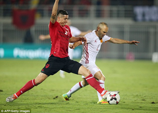 Andres Iniesta is pressed byOdise Roshi (left) as Albania employ spoiling tactics from the start