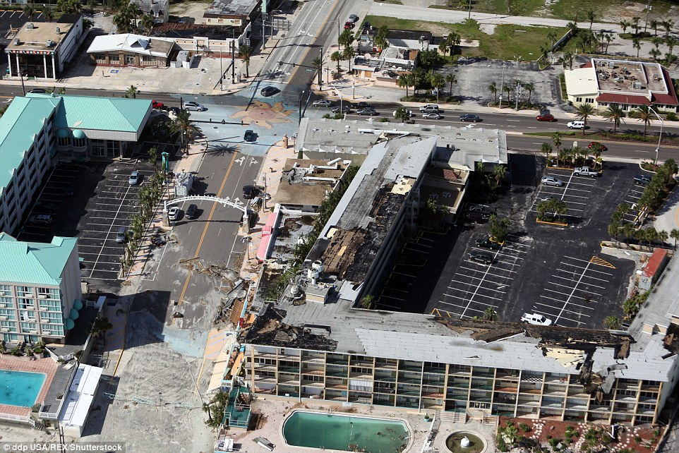 The streets were littered with debris while the roofs showed extensive damage in Florida's Crescent Beach