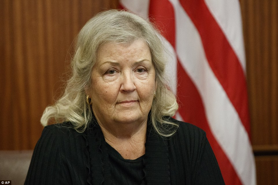 Juanita Broaddrick listens during a meeting with Republican presidential candidate Donald Trump ahead of Sunday's debate