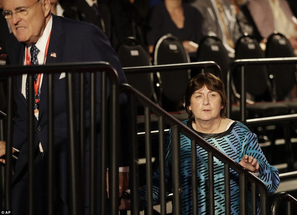 Former New York mayor Rudy Giuliani arrives with Kathy Shelton at the second presidential debate in St Louis