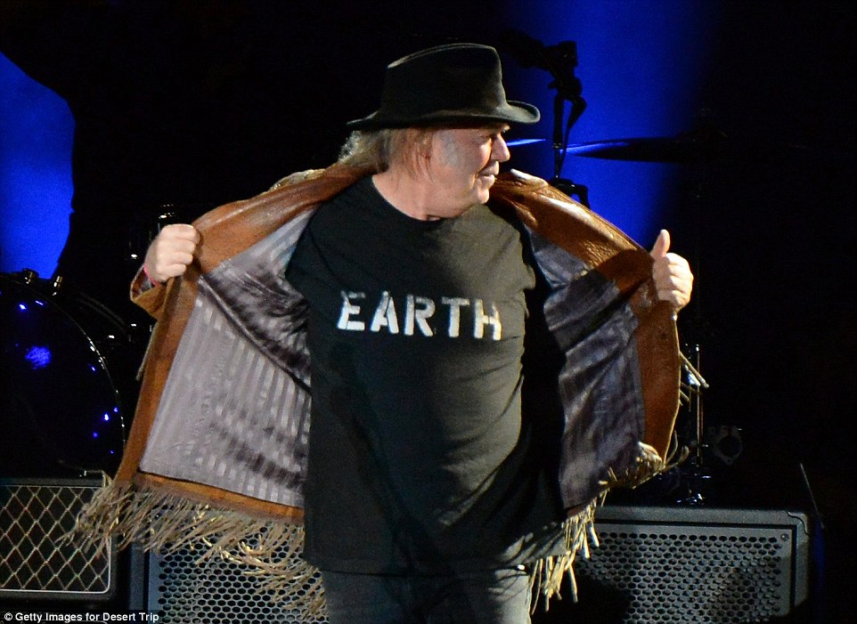 Man of the world: Neil was wearing an 'Earth' T shirt which he displayed proundly